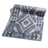 Yoga mat in naturalrubber with a kilim pattern in grey shades.