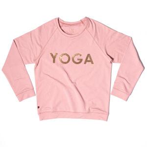 Yogatröja i rosa med texten YOGA av paljetter i guld.