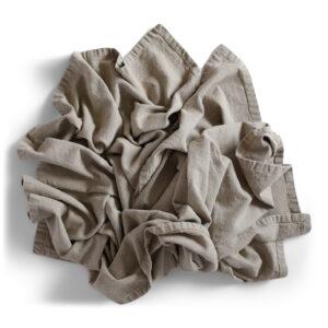 Yoga filt av linne i en hög